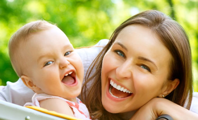 woman and baby laughing close up
